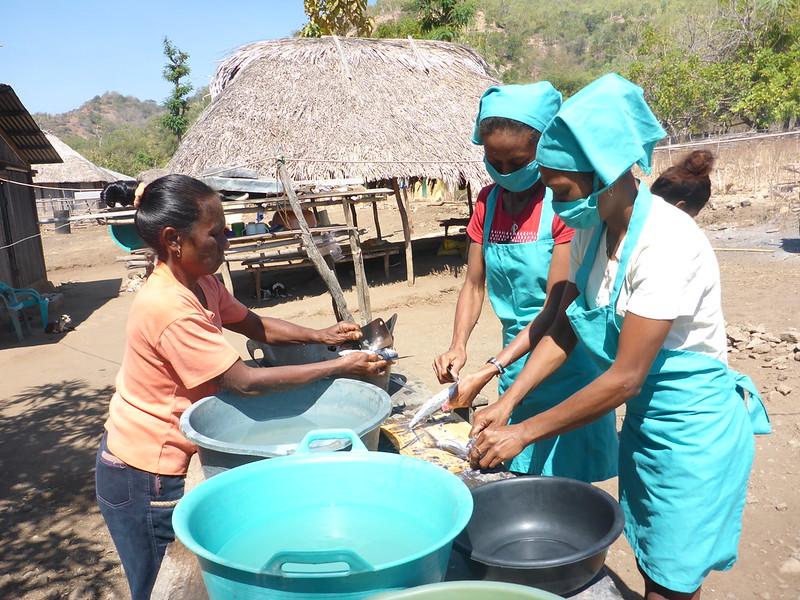WorldFish-supported women's group in Beacou village preparing sardines. Photo: WorldFish