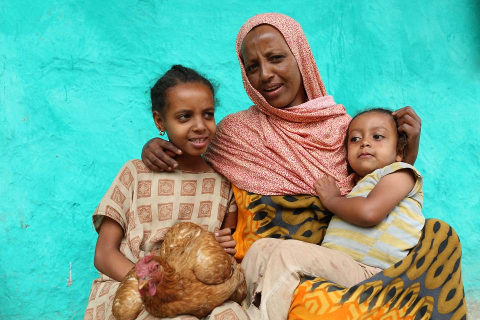 Zenebech Abdu with her children. Photo: Apollo Habtamu/ILRI.